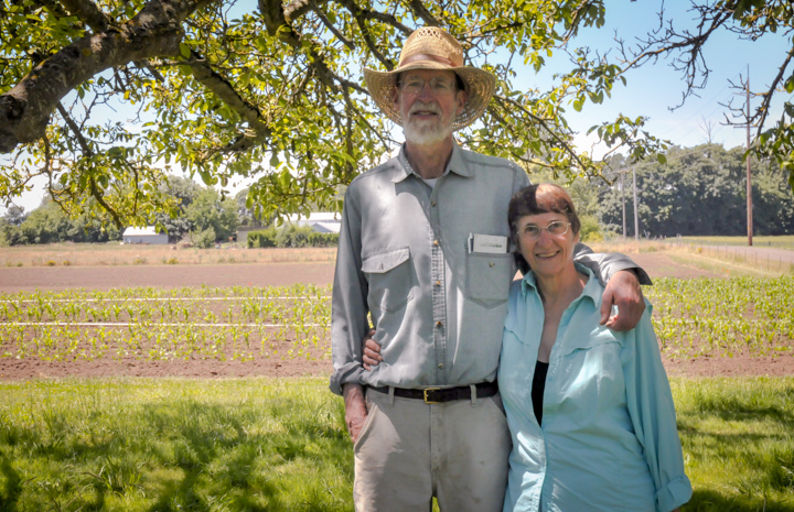 Paul and Nonie Harcombe in front of their corn field at Harcombe Farm