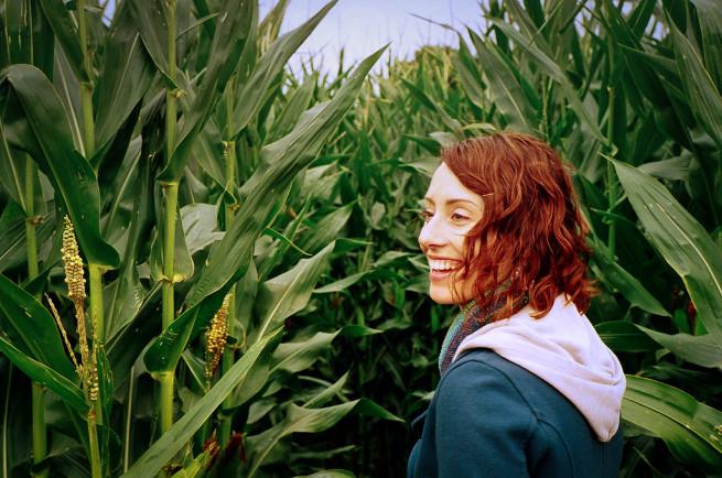Pretty red head in a corn maze