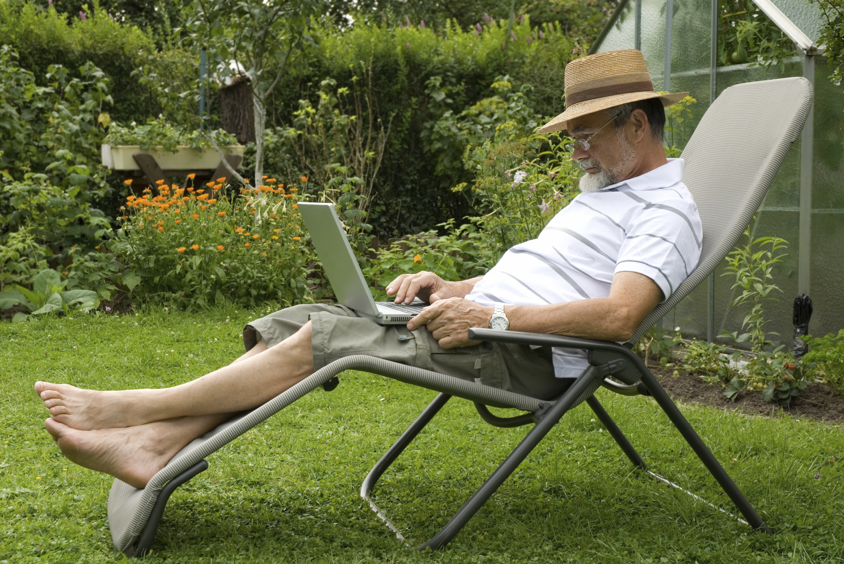 Man in the garden writing on a laptop for Carts and Tools